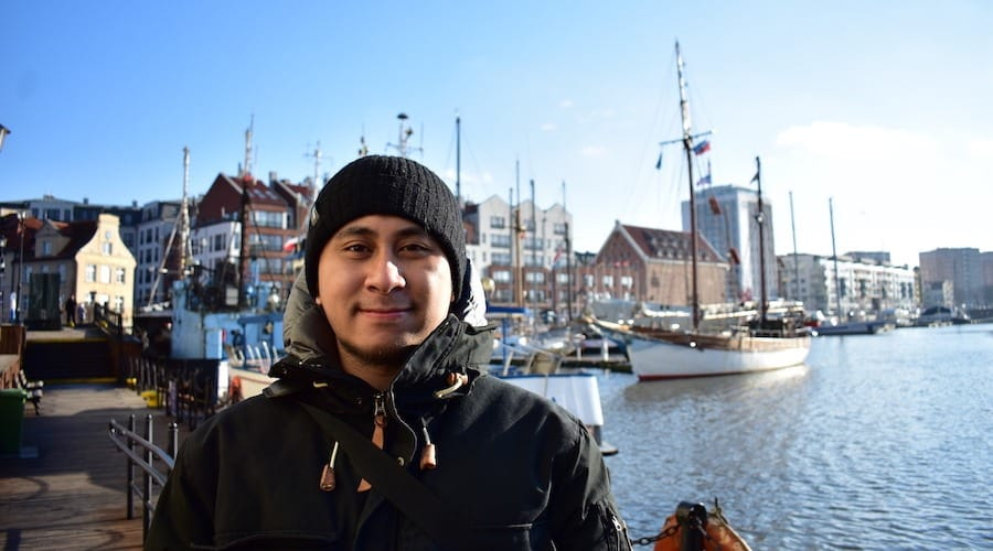 This is me posing on a cold winter morning in Gdańsk, Poland.